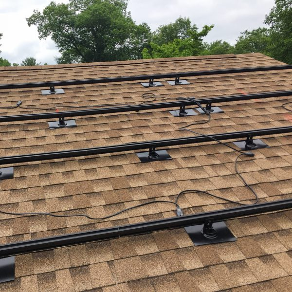 roof showing 4 rows of solar panel mounts
