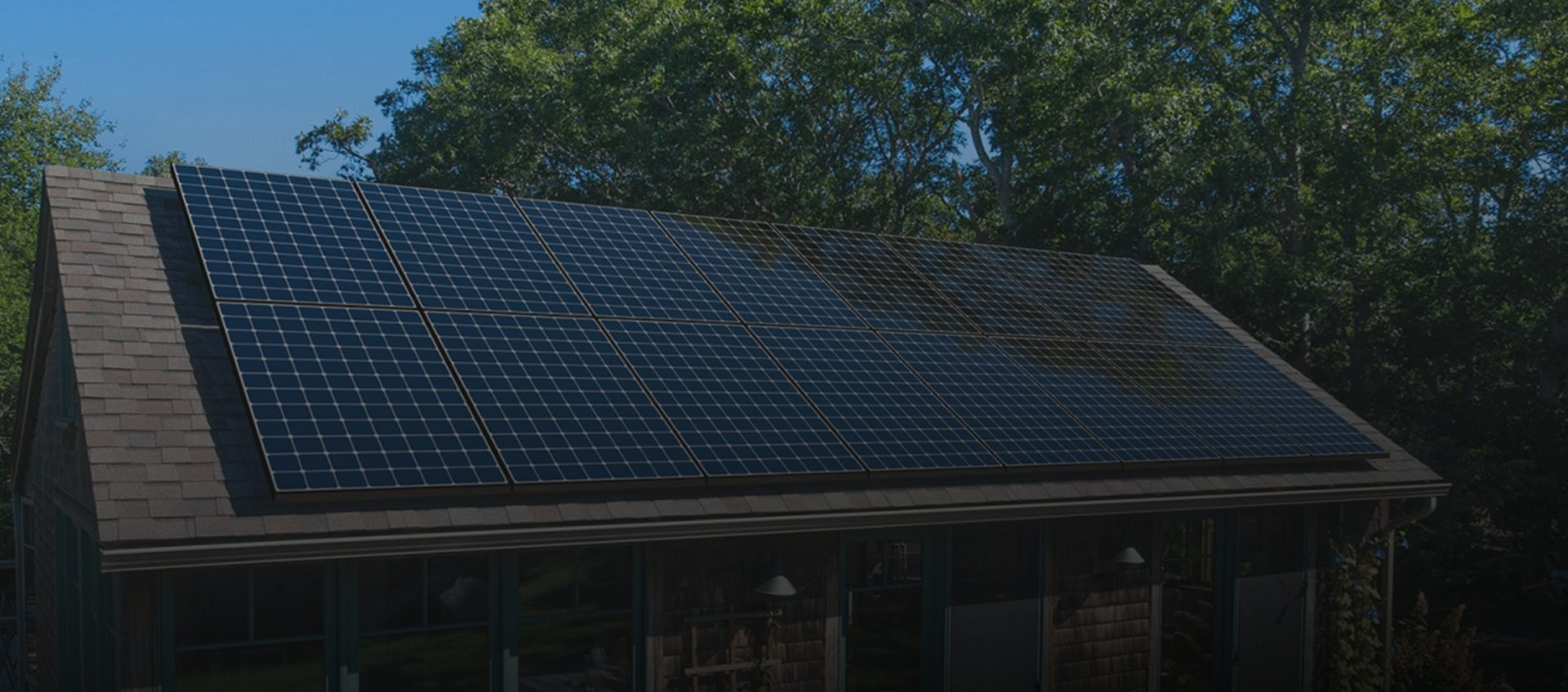 picture of home containing solar panels on the roof